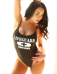 Stunning busty Alluring Vixen babe Jen teases with her big boobs in a skimpy skin tight lifeguard bathing suit