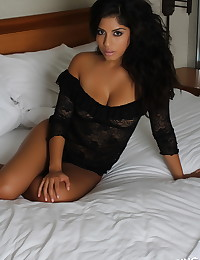 Exotic stunning Alluring Vixen babe Crystal teases in her black rose lace lingerie as she waits for someone to join her