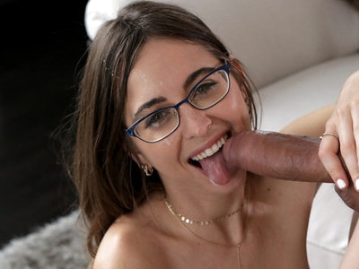 Puffy nipple babe Riley Reid is ready to interview Bambino for the position of pleasuring her. Both of them are dressed to impress in their business finest, each of them looking hot as hell. They try to focus on the business at hand, but the moment Riley is distracted Bambino acts on their flirting to come up behind her and deliver a deep kiss.Instantly putty in Bambino's arms, Riley presses close while Bambino lifts her miniskirt to expose her thong, then lets Bambino put her up on the counter. Soon her hands are working overtime unbuttoning Bambino's shirt as he covers her mouth in kisses. When Riley puts one foot up on the counter to open herself up, Bambino takes the hint and drops to his knees so he can press kisses along her inner thighs.Tugging Riley's thong aside, Bambino applies himself to her pleasure. Riley guides her lover with her long moans and sighs of bliss. When she hops off the counter and kneels before Bambino, Riley is able to give as good as she got in the form of stroking and sucking her lover's big dick. Soon Bambino has wound his hands in Riley's hair so he can anchor himself to properly fuck her face as she deep throats his cock.Relocating to the living room, the two discard all pretense at business along with most of their clothes. Riley quickly finds herself on her back with one high heeled foot in the air and Bambino's stiffie buried between her thighs. She reaches down to rub her clit, prompting Bambino to double down on his efforts to make her cum.Urging Riley onto her hands and knees, Bambino slides into her tight twat from behind. The throbbing length of Bambino's dick hits every one of Riley's buttons as her moans ricochet off the walls. He pounds away at her greedy twat, hanging on to keep Riley right where he wants her until she screams the delight of her climax.Replacing Riley on the couch, Bambino pulls his brown haired lover down into his lap until she's fully impaled on his fuck stick. Riley takes the reins, bouncing up and down on Bambino's fuck rod as she brings herself right to the edge of cumming. When she does climax, she squirts her delight everywhere in a blatant display of unadulterated feminine pleasure.Knowing that he has fully satisfied his bespectacled lover, Bambino rises to his feet while Riley goes to her knees in front of him. She uses both hands to work his hardon, stroking the shaft with quick flicks of her wrist that bring Bambino to the end of his endurance. Letting go, he covers Riley's face in jizz while giving her plenty of hot love in her waiting open mouth.