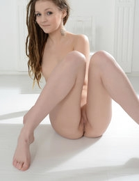 Astonishing cute chick with fantastic body art shows her breathtaking slim body for camera. Perfect nude photo model.