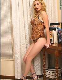Saucy blonde Paula makes music with her body as she mounts the piano to perform for us. Her favorite tune must be 'The Stripper' because that's what she's really good at. Watch her tune up for erotic symphonies in Paula Plays on the Piano