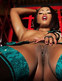 Skin Diamond takes off her sexy lingerie in a red cage.