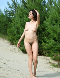 Rimma with hairy cunt sunbathing and strolling on the  beach nude