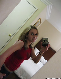 Cute busty girlfriend takes selfshot pictures in a hotel room of her perfect perky tits
