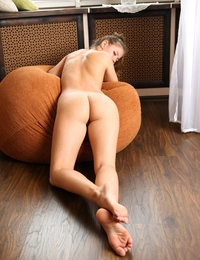 Sexy chick Amy nude on brown bean bag looking delectable and gorgeous
