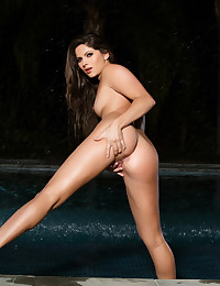 Beautiful Pet Aspen Rae plays in the water and with herself.
