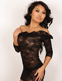 Alluring Vixen tease Kat shows off her tight curves in a sexy black lace dress
