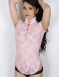 Alluring Vixen Ashley C. loves to tease in her semi sheer pink rose top