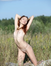 Tall redhead with milky skin Kesy looks nice on outdoor photo session